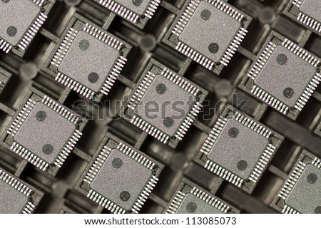SMD integrated circuits on tray - macro small DOF - stock photo