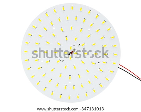 SMD LEDs on Aluminum Printed Circuit Board (PCB) with White Solder Mask, Round Lighting LED Module, Modern and Efficient Lighting, ECO Product - stock photo