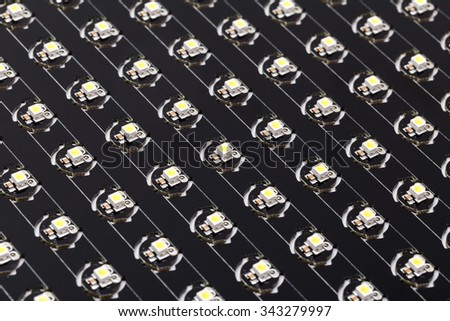 SMD LEDs on Black PCB (Printed Circuit Board), LED lighting, Illumination Elements for Electronic Devices and Industrial Applications, LED Technology Background - stock photo