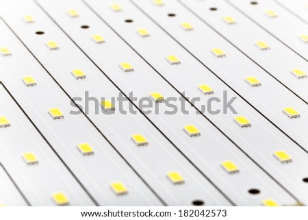 SMD LEDs on White PCB, LED Stripes, Commercial and Industrial LED Light Production - stock photo