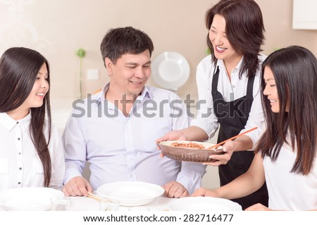 Smells yummy.  Asian family ready to have fresh made lunch. - stock photo