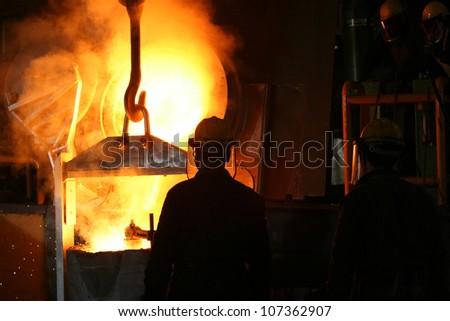 Smelting metal liquid iron foundry - stock photo