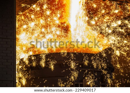 smelting of the metal in the foundry - stock photo