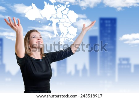 smile and hands of a young woman raised up looking at map - stock photo