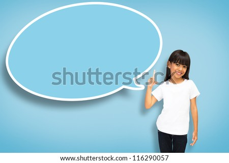 Smile asian little girl with blank speech bubble on blue background - stock photo