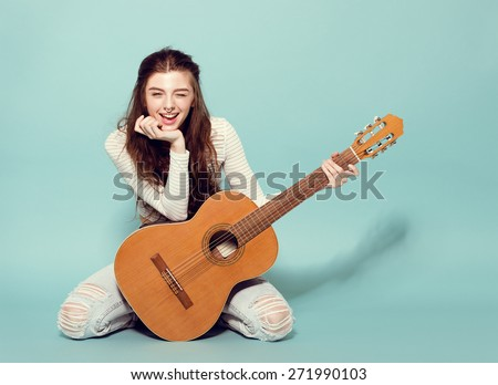 smile beautiful young girl posing with guitar - stock photo