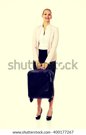 Smile business woman raising her suitcase - stock photo