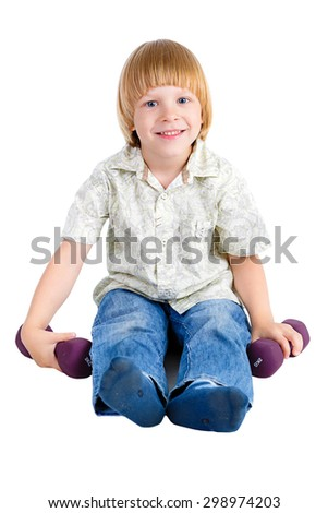 Smile Cute young little boy is sitting on the floor and plays with dumbbells, Isolated on white background, Positive human emotion, facial expression - stock photo