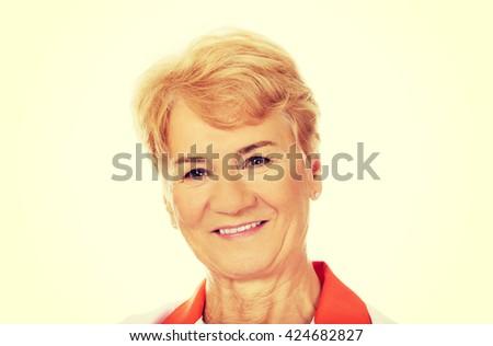 Smile elderly female doctor or nurse  - stock photo