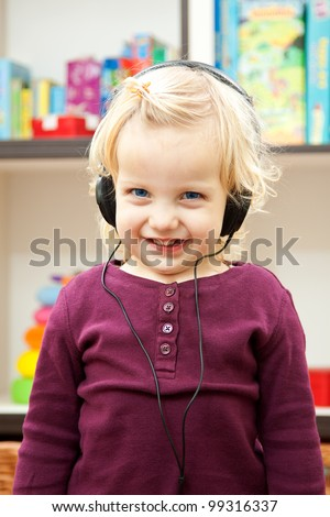 smile girl listening to the music with headphone - stock photo