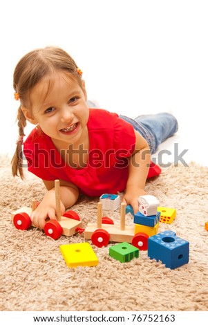 smile girl playing with wood toys - stock photo
