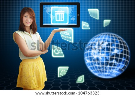 Smile lady hold Bin icon on tablet pc : Elements of this image furnished by NASA - stock photo