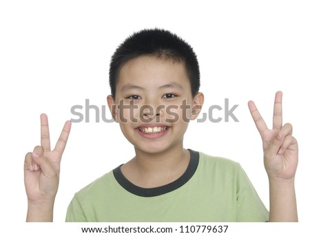 Smile little boy holding up the peace sign, - stock photo