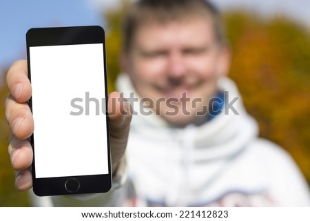 smile man holding smartphone in hand - stock photo