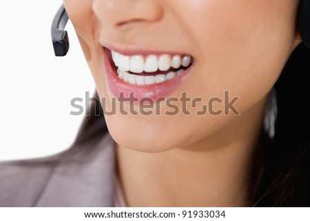 Smile of female call center agent against a white background - stock photo