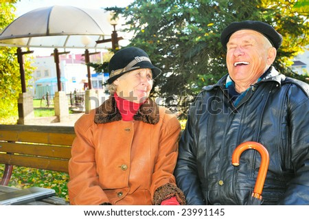 smile old man with old woman - stock photo