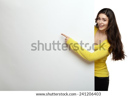 Smile woman standing pointing her finger at board - stock photo