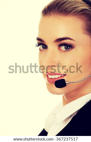 Smile young businesswoman with headset - stock photo