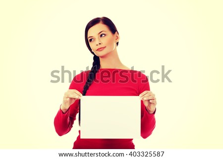 Smile young woman holding blank white banner - stock photo