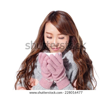 smile young woman holding cup of coffee or tea and wearing winter clothing isolated over white background, asian - stock photo
