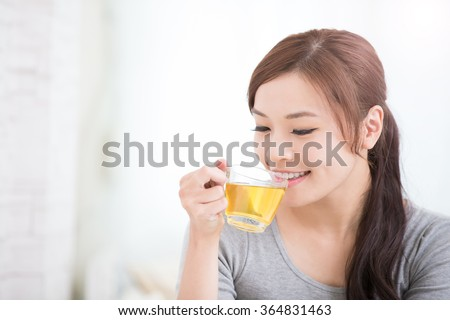 smile young woman holding cup of  green tea at home, healthy lifestyle concept, asian beauty, asian beauty - stock photo