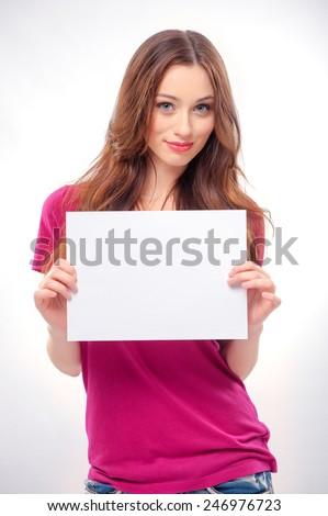 Smile young woman portrait with blank white banner, board on white isolated . Female model with long hair. - stock photo