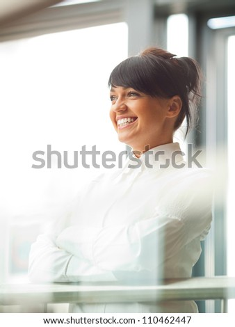 Smiled business woman in shopping mall. - stock photo