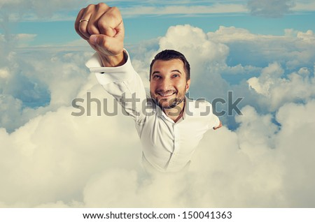 smiley and happy man flying in the sky - stock photo