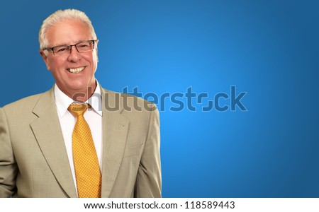 Smiley Businessman On Blue Background - stock photo