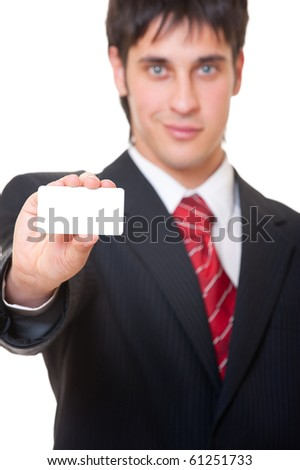 smiley businessman showing business card over white background - stock photo