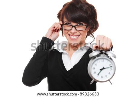 smiley businesswoman holding alarm clock. isolated on white background - stock photo