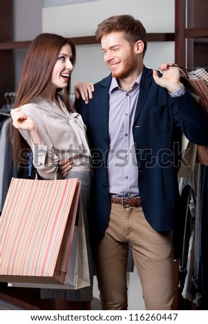 Smiley couple likes shopping - stock photo
