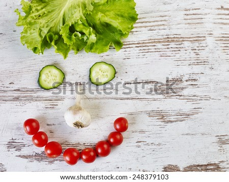 Smiley face with vegetables - stock photo