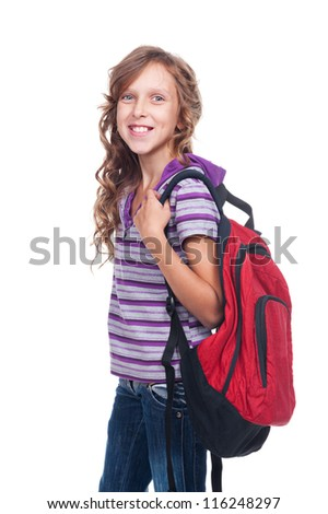 smiley girl of about ten holding red rucksack. isolated on white background - stock photo