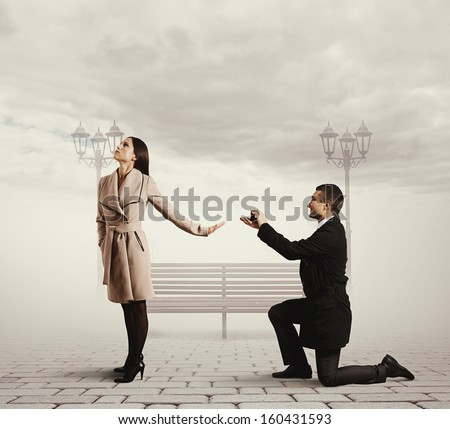 smiley handsome man making proposal of marriage the woman - stock photo