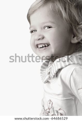 Smiley happy little girl close-up on white background - stock photo