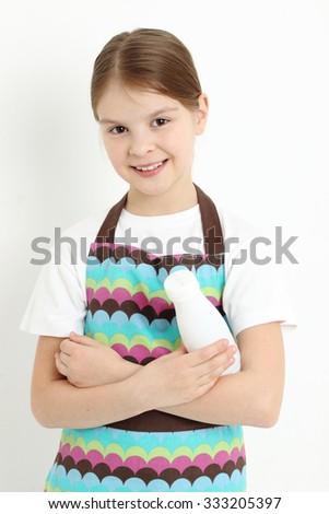Smiley teen girl holding a milk bottle - stock photo