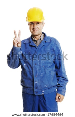smiley workman showing victory sign. isolated on white - stock photo