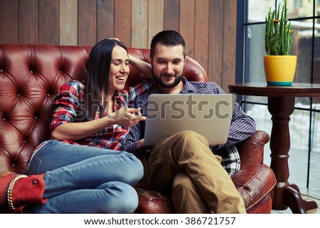 smiley young couple have a on-line shopping - stock photo