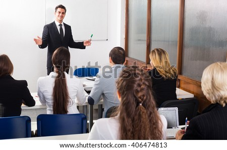 Smiling adult professor and professionals at extension business courses - stock photo