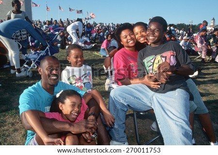 Smiling African American family at Black Family Reunion Celebration, Washington D.C. - stock photo
