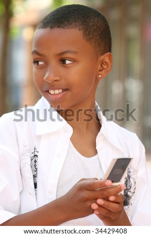 Smiling African American Teenager Boy talking on Cell Phone - stock photo