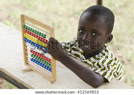 Smiling African Boy with an Abacus - stock photo