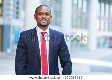 Smiling african businessman outdoor - stock photo