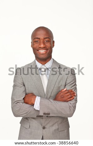 Smiling Afro-American businessman with folded arms against white background - stock photo