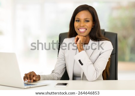 smiling afro american businesswoman working in office - stock photo