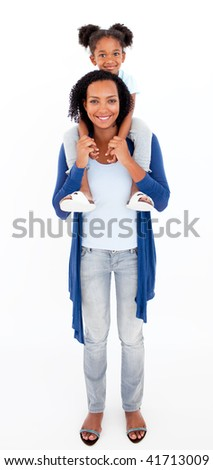 Smiling Afro-american mother giving her daughter piggiback ride - stock photo