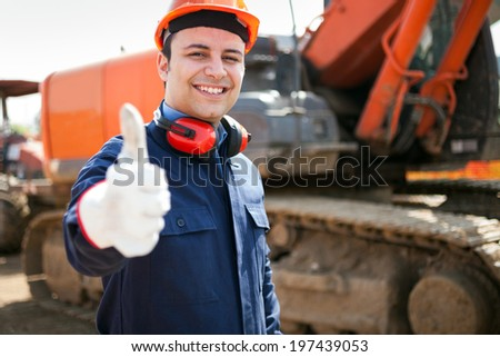 Smiling architect in a construction site - stock photo