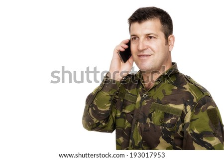 Smiling army veteran on the phone - stock photo