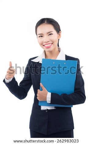 Smiling asian business woman gives a thumb up gesture. Business woman presenting a copyspace. Isolated on white background. - stock photo